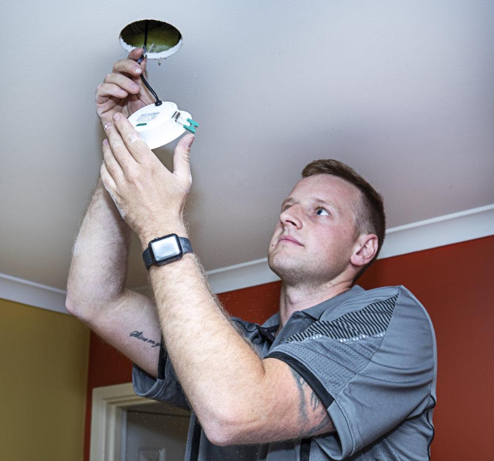 Electrician fixing lighting