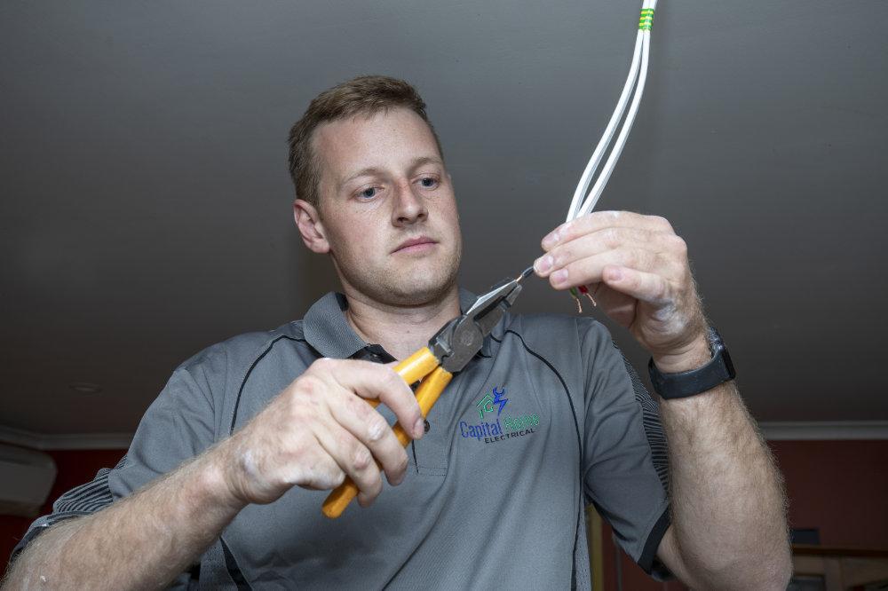 Matt Young, Electrician fixing wiring